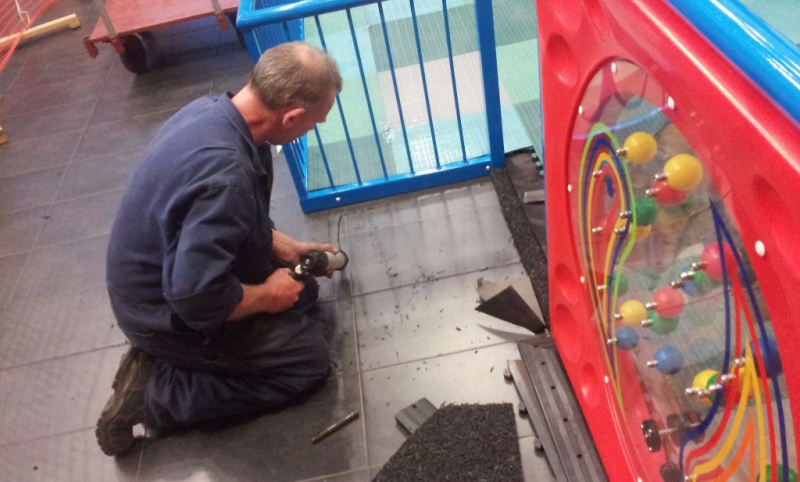 Our highly skilled engineer seen here installing the Playmatta Safety Tiles.