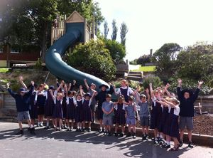 Children excited in anticipation for the first go on their new tunnel Slide designed, manufactured by Playgear™ by A.J Grant, Dunedin.