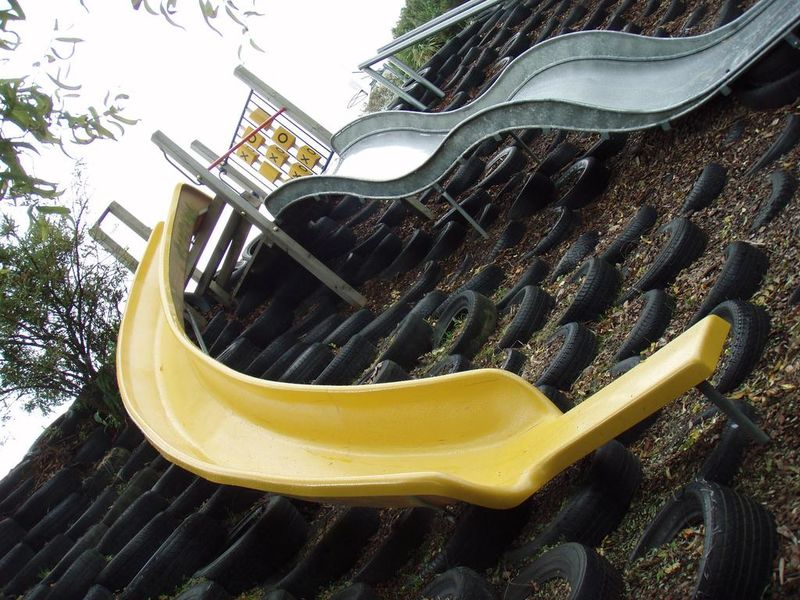PLAYGEAR™ curved Fibreglass Slide and a Stainless Steel long Wavy Slide